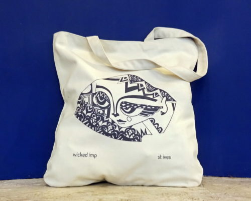 organic cotton shopping bag with blue graphic of feisty female head
