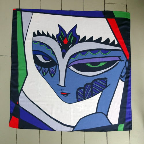 bold and bright square scarf of a feisty female, Fiona the Fierce looking over her shoulder right at you.