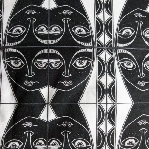 "wicked imp designs limited edition cotton fabric ""by the sea"" black and white head of a woman mirror repeat"