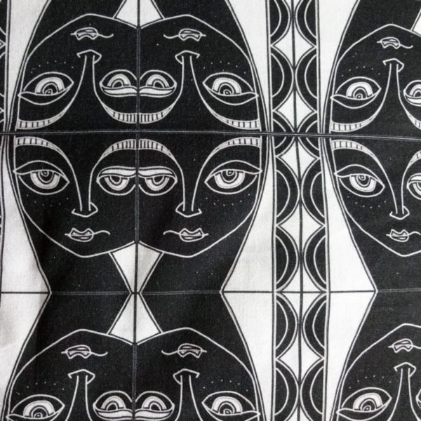 """wicked imp designs limited edition cotton fabric """"by the sea"""" black and white head of a woman mirror repeat"""