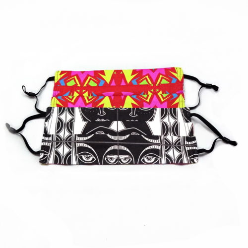 by the sea pleated face mask black and white print of faces to one side and colourful abstract pattern to other side both being shown