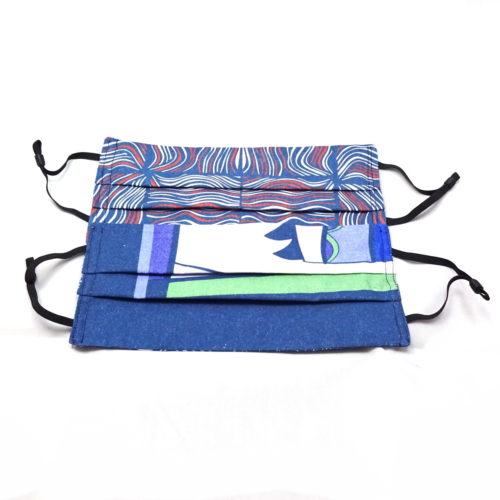 pleated fabric masks blue red and white abstract waves to one side and blue green white purple grey abstract to the other side
