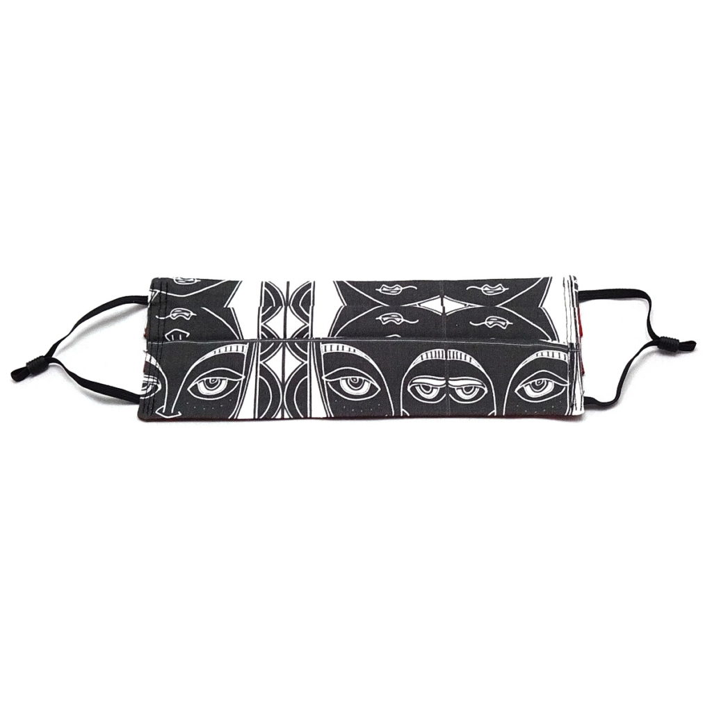 by the seaside pleated fabric mask with black and white stylised face wicked imp designs