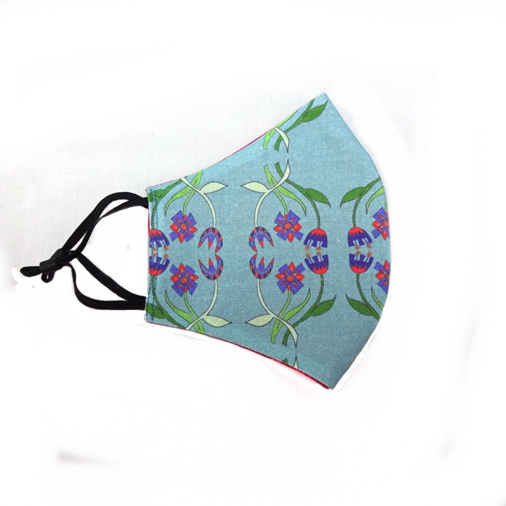 wicked imp designs fitted fabric face mask with stylised flower motif